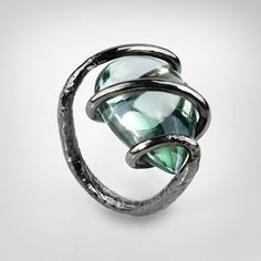 Ring | German Kabirski.  Sterling silver plated with black rhodium and a green amethyst.