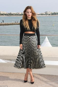 Spot on! Riley Keough showed off her fashion credentials in a short crop top and pleated skirt as she attended a photocall for her latest project The Girlfriend Experience in Cannes on Monday