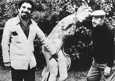 1956. The exiled Pablo Neruda (right) shares a moment with García Márquez -- and a lovely Nymph -- in Paris.