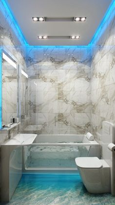 sweetestesthome: This small bathroom has big ideas; bright blue led lighting trims the perimeter of the ceiling and vanity mirror, and underlines a glass sid…