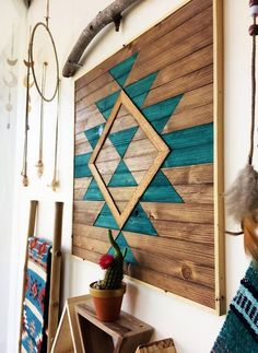 Let's check out this boho style interior decoration idea. This captivating idea is also DIY project that you can easily craft out with the pallet planks of your house. The fantastic use of colors and the arrangement of various products are delivering a long-lasting bohemian vibe to it.