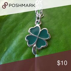 Four Leaf Clover Necklace Beautiful Clover Necklace. Chain is silver plated finished with a lobster claw clasp. Measurements of the clover are 1/2 inch tall by 1/2 inch wide. Chain length is 18 inches Jewelry Necklaces