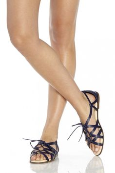 Gladiator-inspired leather lace-up sandal in dark blue ==