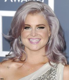 Kelly Osbourne with cool lilac and silver toned hair at the 54th Annunal Grammy Awards.