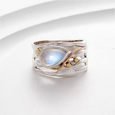 Organic Silver & Moonstone Ring £60.00 Beautiful Moonstone set in organic Silver with Gold fill detail Available in sizes L-S Buy here - www.reppinandjonesjewellers.co.uk