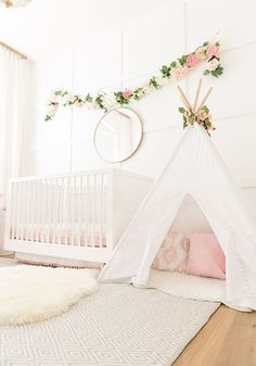 Blush Pink Baby Girl nursery, nursery inspirations, teepee, white cot, flower garland, simple nursery ideas