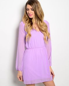 """This stunning long sleeve, chiffon pleated dress is perfection. The open back trimmed in lace makes it even sweeter. Feel like a princess in this number. Model is wearing size Small. L: 34"""" B: 17"""" W:"""