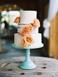 wedding cake with orange roses - photo by Adam Barnes http://ruffledblog.com/virginia-hillside-wedding-on-film