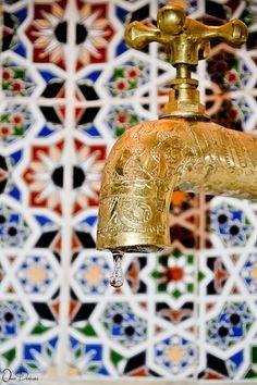 vintage faucet + Moroccan tile