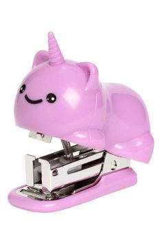 Small plastic and metal stapler shaped like a cat with a unicorn horn. Size 2 x 2 in.