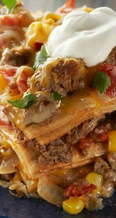 Easy Baked Taco Pie ~ Here's everything you love in a taco—from the ground beef and veggies to the dollop of sour cream on top—all in one easy, baked pie recipe