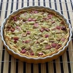 Fresh rhubarb is cut into small pieces and piled into a prepared crust. A creamy custard filling is stirred up with eggs, a bit of milk, flour, sugar and nutmeg, and then it 's poured over the rhubarb. The pie is slipped into the oven for an hour until the custard is set. Cool it slightly before serving.