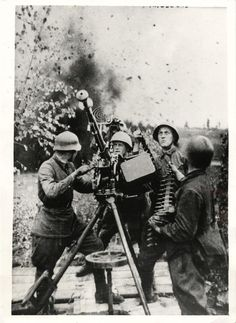 https://flic.kr/p/eZHmTd | Russian Red Army crew | 1942- Russian Red Army crew keeps anti-aircraft machine gun trained on German planes that are attempting to attack Soviet battery
