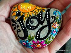 joy. happiness. take joy. celebrate life. another day in paradise.  painted rock (sea stone) from Cape Cod.  A beautiful, gray stone, worn smooth