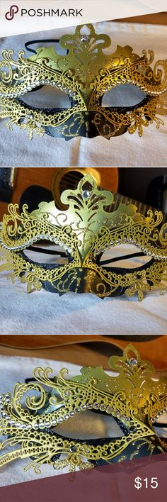 Costume ball mask. Beautiful gold and black mask, embellished with glitter and sparkly jewels. Some components of the mask are metal, while others are plastic. It has an elastic strap that keeps it securely on your face. It has never been used and is an excellent condition. no idea! Other