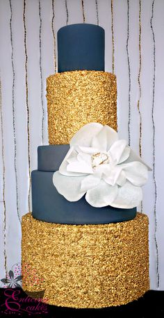 Sapphire Serenade - This Five Tier Wedding Cake features two double barrel tiers of gilded sequins and an extra large wafer paper fantasy flower. And is Part of our Midnight Glam mini Collection