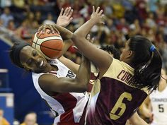 Canada forward Tamara Tatham, left, and Venezuela forward Yosimas Corrales Gomez fight for a loose ball in the women's basketball preliminary round during the Pan Am Games in Toronto.  John David Mercer, USA TODAY Sports