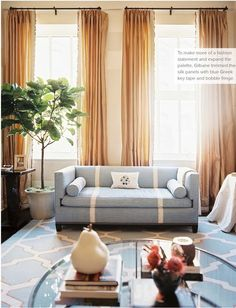 Sara Gilbane in Trad home. sofa stripe and ruffle on curtains