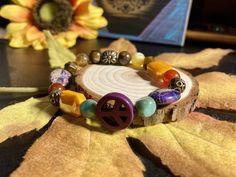 Excited to share this item from my #etsy shop: Peace Sign Bracelet. Womens Gift. Men's Gift. BOHO Bracelet. Boho Chic. Good Vibes #no #unisexadults #bohohippie #purple #purplebracelet #orange #peacesign #bohochic #peace #boho #bohemian #yoga Hippie Boho, Bohemian, Gifts For Women, Boho Chic, Beaded Bracelets, Peace, Yoga, Etsy Shop, Orange