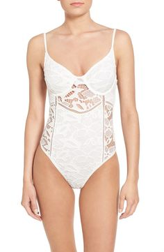 Obsessing over this white one-piece swimsuit with sheer accents and lace. It will be perfect for the chic bride on her honeymoon.
