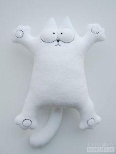 Descarga unos cuantos patrones de un cojín gato. Originales, divertidos y gratuitos.