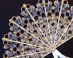 Fan made by quilling - really intricate paper art and beautiful...