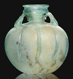 A ROMAN BLUE GLASS ARYBALLOS CIRCA 1ST-2ND CENTURY A.D.