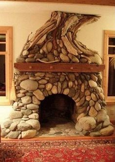 stone fireplace in a hobbit house Hobbit Hole, The Hobbit, Deco Originale, Earthship, Fireplace Design, Mosaic Fireplace, Fireplace Stone, Log Homes, My Dream Home