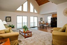 The elevated ceilings and windows in the living room makes for a beautiful design. Check out this home online or in person at our Duncansville location. Building Systems, Modular Homes, Black House, Living Room, Bedroom, Ceilings, Furniture, Windows, Design