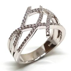 A unique modernist interpretation of an engagement ring. An open weave of round cut white diamond simulants creates attention and a refreshingly airy ring. Cubic Zirconia Engagement Rings, Modern Engagement Rings, Diamond Simulant, Dress Rings, Open Weave, Semi Precious Gemstones, Jewelry Branding, Jewelery, Silver Rings