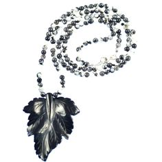 MEXICAN JASPER LEAF NECKLACE    Mexican jasper and sterling silver long necklace with black agate leaf pendant.     Pretty monochrome necklace that works well with most outfits. Matching items available.  ...  Colour: Black/White    Size: 73cm    £57.00     http://www.gemjewelleryshop.com/product-information/36/385/mexican-jasper-leaf-necklace/See More