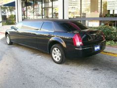 2007 Black 70-inch custom built Chrysler 300 6 passenger limousine for sale #645 built by American Limousine Sales features: mirrored ceiling, bench to bench seating, rear stereo with cd player, dvd player, limo touch control system, flat screens, cup holders, rear a/c and heating, single window design, led opera lights, Bentley grill, and much more Please call or text 323-209-8510 for more info