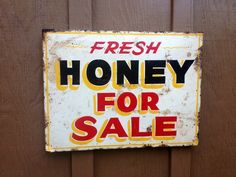 Vintage Folk Art HONEY Roadside Stand Farm Trade Sign - ORIGINAL VINTAGE ART!   It's a very old enamel baked on paint on metal.  The metal sign is mounted to the original old wooden frame backing.      It measures 19 x 24 x 3/4 inches.  Weight 3.5 pounds