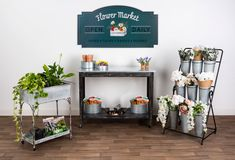 These Galvanized Retail Displays Can be Paired Together for a Rustic Looking Retail Display Galvanized Buckets, Galvanized Steel, Garden Center Displays, Rustic Tabletop, Garden Cart, Store Fixtures, Graphic Design Services, Home Decor Shops, Flower Market