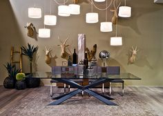 Give your walls some character and personality for a modern meets eclectic look! Our coveted Spyder Dining Table by Cattelan won't be the only topic of conversation at dinner, so will the hand carved basswood game heads, an animal friendly alternative to the real deal…find your inspiration on the Cantoni Blog: http://cantoni.com/blog/2014/07/modern-meets-eclectic/