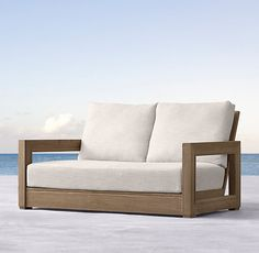 """RH's 55"""" Costa Classic Sofa:An antique mirror's elegantly molded frame forms a repeating architectural leitmotif in this collection,…"""