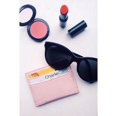 Wanderess must haves: great pair of #sunnies, simple #cardholder, hydrating #lipbalm, and flirty pink #blush. #makeupmonday #wanderbeauty