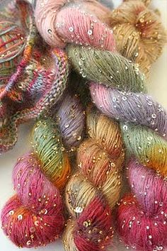 Beaded Mohair with sequins This amazing colorway is one we refer to as Candyland - the blend from lovely oranges and pinks to blues and greens are an amazing achievement - not a muddy color in site. 80% Silk/20% kid mohair with glass beads and sequins  114 Yards/104 Meters 50 grams 4.5 st per inch/size 7 needles  30% Off $33.60