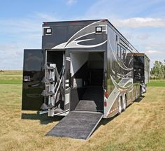This horse trailer model, Featherlite has massive luxury living quarters with four slide outs that dramatically expand the interior space. Behind the owners' living quarters is an upper-deck three-horse slant load plus one-horse straight load configuration. If no horse is transported in the straight-load stall, there is enough room to garage a golf cart or ATV for the trip.