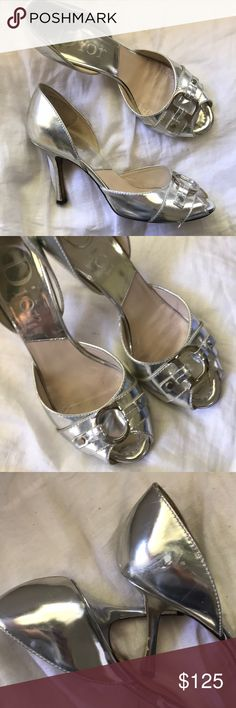 🔥SALE🔥 Dior Silver peep toe pumps Follow that silver trend with these designer shoes. Good for a wider bridge. True size 7. A little sticky in heel because I remove teal pants. Attempted to remove some blemishes but it took off some of the silver paint. I bought silver paint and I will attempt to touch up. Dior Shoes Heels