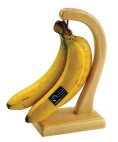 Keep those Fairtrade bananas free from bruises with this simple wood banana tree.  Made from rubberwood, it has a sturdy base and metal hook to hang your fruit.  The wood is polished and varnished for an easy, wipe-clean finish so is suitable for your kitchen.  This wood banana tree was handmade in India. #fair #trade #home #ethical #gifts