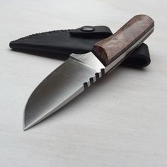 Small camp knife with a beautiful redwood burl handle.