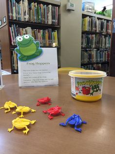 practice fine motor skills by hopping these frogs into the bucket