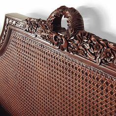 Frontgate.com | Beauvier French Cane Bed | mahogany or antique white | Intricate handcarved detail and handwoven caning distinguish our solid-mahogany Beauvier Cane Bed. Crafted in the style of Louis XVI, with straight lines and classic Greco-Roman ornamentation, the bed features an exquisite twisted ribbon carving leading up to floral swag and laurel wreath | Item 63340 | Queen: 5,495.00 | King: 5,995.00