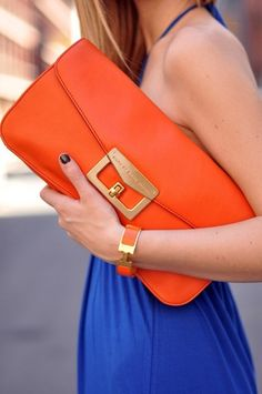 love the orange marc jacobs bag and the hermes cuff.the blue brings out the orange.*blue and orange perfect colour blocking combination* Look Fashion, Fashion Bags, Fashion Accessories, Womens Fashion, Orange Accessories, Fashion Handbags, Cheap Fashion, Fashion Spring, Blue Fashion