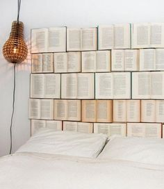 If you want to update the look of your bedroom, but don't want to spend a load of money on redecorating and brand new furniture, the DIY Book Headboard is a fun and inexpensive way to change things up. The DIY Book Headboard is a fun decoration project. Book Headboard, Headboard Ideas, Diy Storage Headboard, Floating Headboard, Bookshelf Headboard, Bookshelf Wall, Queen Headboard, Old Book Art, Diy Vintage