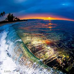 Clark Little Photography - Sunset photo taken on the north shore of Oahu with a fisheye lens and flash.