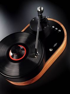 "AMG Viella 12 ""V12"" turntable    Precision engineering and classic design are embodied in the first turntable from AMG (Analog Manufaktur Germany), the Viella 12 or simply, V12. The AMG turntable line was created by a group of audio industry experts to advance the art of vinyl playback"