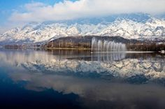 You'd be forgiven for thinking it isn't real, but it is. Behold the snow-covered Zabarwan Mountains, beautifully reflected on the waters of Dal Lake in Srinagar, Kashmir.