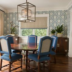Dining Room: I'm really loving a wallpaper in here but I also love the light fixture and blue chairs. I think a pop of print/color is fun and unexpected but still transitional.